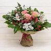 Букет из роз, орхидей, хризантем, альстромерий, гиперикума в крафтовой упаковке