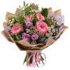 Букет из роз, тюльпанов, хамелациума и декоративной зелени в крафтовой упаковке